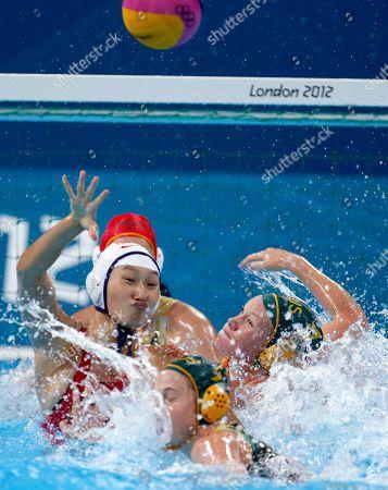 Sun Huizi, Jane Moran, Rowie Webster Sun Huizi, left, of China passes the ball as Australia's Jane Moran, center, and Rowie Webster defend during their women's water polo quarterfinal match at the 2012 Summer Olympics, in London