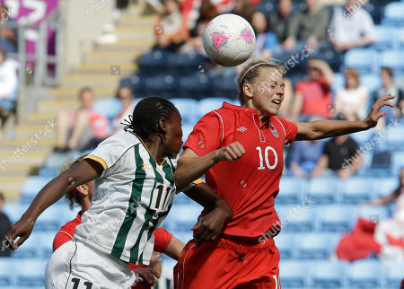 Canada's Lauren Sesselmann, right, battles for the ball against South Africa's Noko Matlou during the group F women's soccer match between South Africa and Canada at the London 2012 Summer Olympics, in Coventry, England