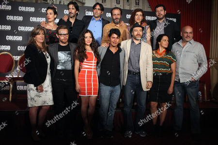 "Mexican movie director Carlos Bolado, top row, third from left, poses for photos with cast members during a press conference to promote his latest film, ""Colosio, el Asesinato"" in Mexico City, . The film, a political fiction thriller, based on the 1994 murder of Luis Donaldo Colosio, then candidate of the Institutional Revolutionary Party (PRI), seeks to raise awareness among Mexican citizens and motivate them to cast an informed vote"