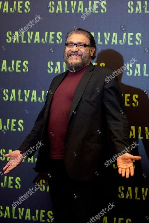 "Mexican actor Joaquin Cosio poses for photos during a photo call to promote his new movie, drug-war thriller ""Salvajes,"" or ""Savages,"" in Mexico City"