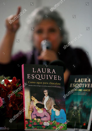 """Laura Esquivel The novel """"Like Water for Chocolate"""" sits on display during a news conference by its author, Mexican writer Laura Esquivel, in Mexico City, . Esquivel announced that Grupo Santillana has acquired the rights to publish all her books"""