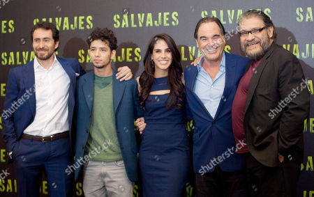 "Oliver Stone, Demian Bichir, Joaquin Cosio, Diego Catano, Sandra Echeverria Mexican actors Demian Bichir, left, Diego Catano, second left, Sandra Echeverria, center, and Joaquin Cosio, right, pose for photos with filmmaker Oliver Stone, second right, during a photo call to promote their new movie, drug-war thriller ""Salvajes,"" or ""Savages,"" in Mexico City"