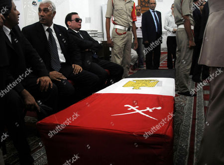 Mourners surround the coffin holding the remains of Egypt's former spy chief, Omar Suleiman in Cairo, Egypt, . Egypt's top military commander and mourners attended a military funeral honoring Egypt's former spy chief Omar Suleiman, who died in a U.S. hospital at the age of 76