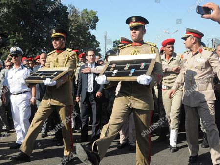 A military honor guard marches with medals at the funeral for Egypt's former spy chief, Omar Suleiman in Cairo, Egypt, . Egypt's top military commander and mourners attended a military funeral honoring Suleiman, who died in a U.S. hospital at the age of 76