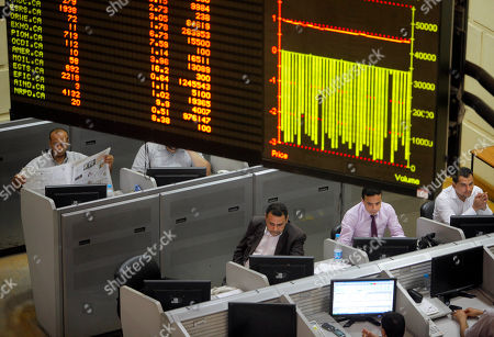 Egyptian traders monitor their screens at Egypt's benchmark stock in Cairo, Egypt, . Analysts say investor optimism has been fueled by the declaration of a winner in the tight presidential race between Mohammed Morsi of the Muslim Brotherhood and Ahmed Shafiq, the last prime minister of deposed leader Hosni Mubarak