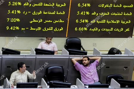 Stock Picture of Egyptian traders chat at Egypt's benchmark stock in Cairo, Egypt, . Analysts say investor optimism has been fuelled by the declaration of a winner in the tight presidential race between Mohammed Morsi of the Muslim Brotherhood and Ahmed Shafiq, the last prime minister of deposed leader Hosni Mubarak