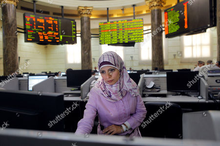 An Egyptian trader checks her screen at Egypt's benchmark stock in Cairo, Egypt, . Analysts say investor optimism has been fueled by the declaration of a winner in the tight presidential race between Mohammed Morsi of the Muslim Brotherhood and Ahmed Shafiq, the last prime minister of deposed leader Hosni Mubarak