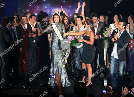Miss Serbia Mina Milutinovic, center, reacts after being crowned Miss World in the Next Top Model 2012 contest, in Beirut, Lebanon, late . Thirty-eight models gathered from all over the world to compete in the biggest international event to be held in Lebanon