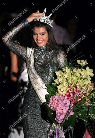 Mina Milutinovic from Serbia reacts after being crowned Miss World in the Next Top Model 2012 contest, in Beirut, Lebanon, late . Thirty-eight models gathered from all over the world to create the biggest international event to be held in Lebanon