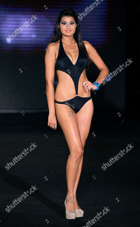 Newly crowned Mina Milutinovic from Serbia models a swimsuit before being crowned Miss World in the Next Top Model 2012 contest, in Beirut, Lebanon, late . Thirty-eight models gathered from all over the world to compete in the biggest international event to be held in Lebanon