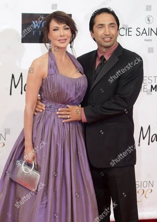 American actress Hunter Tylo poses with her husband Gersson Archila during the opening ceremony of the 2012 Monte Carlo Television Festival, in Monaco