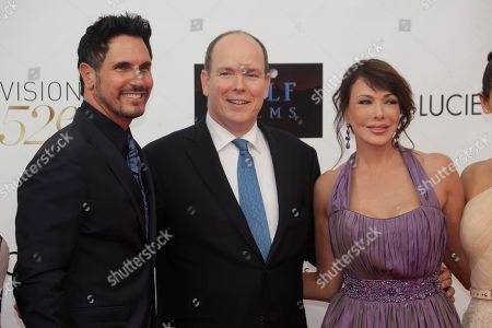 Prince Albert II of Monaco, center poses with the 'Bold & Beautiful' cast, left to right US actors Don Diamont and Hunter Tylo during the opening ceremony of the 2012 Monte Carlo Television Festival, in Monaco