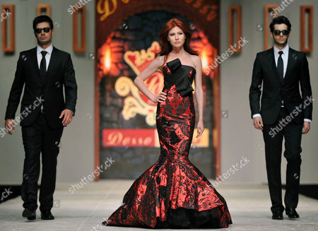 Anna Chapman Russian ex-spy Anna Chapman, center, walks a Turkish catwalk flanked by two men posing as secret service agents at a fashion show in Antalya, Turkey. The embarrassing arrest of a suspected CIA officer in Moscow is the latest reminder that, even after the Cold War, the U.S. and Russia are engaged in an espionage battle with secret tactics, spying devices and training that sometimes isn't enough to avoid being caught. In a case that made headlines across the world, the FBI in 2010 wrapped up a ring of sleeper agents it had been following for years in the United States. Eventually the sleeper agents, including Chapman, were returned in a swap