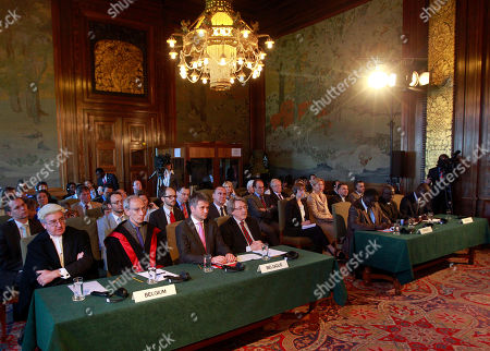 """General view of the court showing the delegation of Belgium, front table left, left to right: Sir Michael Wood, Eric David, Gerard Dive and Paul Rietjes and the delegation of Senegal, front table right, left to right; Cheikh Tidiane Thiam, Amadou Kebe and Moustaph Sow, at the International Court of Justice in The Hague, Netherlands, . The United Nations' highest court has ordered Senegal to prosecute former Chadian dictator Hissene Habre on torture charges """"without further delay"""" if the country does not extradite him to Belgium. Habre is accused of torturing hundreds of his opponents to death during his 1982-1990 rule in the Central African nation before fleeing to Senegal"""