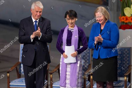 Aung San Suu Kyi, Thorbjorn Jagland, Kaci Kullmann Myanmar opposition leader Aung San Suu Kyi, center, receives the applause from the chairman of the Norwegian Nobel Committee Thorbjorn Jagland, left, and deputy chairwoman Kaci Kullmann Five after her speech at the Peace Nobel Prize lecture at the city hall in Oslo, . Burmese opposition leader Aung San Suu Kyi Nobel peace prize laureate, formally accepts the prize that thrust her into the global limelight two decades ago. Suu Kyi says the Nobel Peace Prize she won while under house arrest 21-years ago helped to shatter her sense of isolation and ensured that the world would demand democracy in her military-controlled homeland