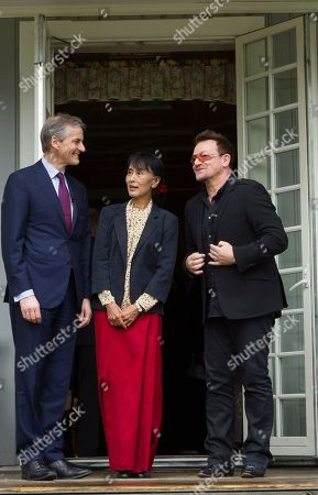 Bono, Aung San Suu Kyi, Jonas Gahr Store From left, Norwegian Foreign Minister Jonas Gahr Stoere, Myanmar opposition leader Aung San Suu Kyi and Irish singer and activist Bono pose for the media after they attending a conference of the Oslo Forum at the Losby Gods resort, about 13 kilometers (8 miles) east of Oslo, . The Oslo Forum is a n international network of armed conflict mediation practitioners