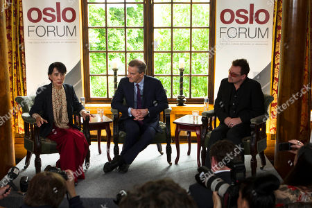 Bono, Aung San Suu Kyi, Minister Jonas Gahr Store From left, Myanmar opposition leader Aung San Suu Kyi, Norway's Foreign Minister Jonas Gahr Stoere and Irish singer and activist Bono address the media after attending a conference of the Oslo Forum at the Losby Gods resort, about 13 kilometers (8 miles) east of Oslo, . The Oslo Forum is an international network of armed conflict mediation practitioners