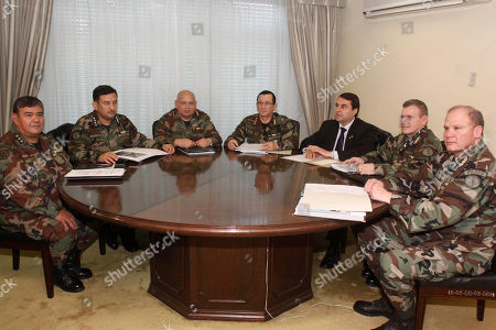 Military officers, from left to right, Strategic High Studies Institute Director Gen. Luis Noceda, Navy Commander Almirant Juan Benitez, Army Commander Gen. Adalberto Garcete, Armed Forces Commander Gen. Felipe Melgarejo, Air Force Commander Gen. Miguel Jacobs, and Logistic Commander Gen. Julio Peralta pose for a picture with Paraguay's President Federico Franco, third from right, during meeting in Asuncion, Paraguay, . Franco, the former vice president, took office as president after the removal of President Fernando Lugo, and intends to serve out the remainder of his term until August 2013