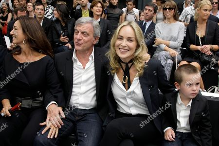 Sharon Stone, Sidney Toledano, Quinn Kelly Stone Dior president Sidney Toledano, second left, Sharon Stone, and son Quinn Kelly attend the show of Belgian fashion designer Kris Van Assche for Dior as part of the Men's Spring-Summer 2013 collection, for the Paris Fashion Week, in Paris, France
