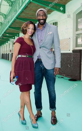 Amare Stoudemire, Alexis Welch U.S basketball player Amare Stoudemire, right, and Alexis Welch poses prior to Paul Smith's Men's Spring-Summer 2013 collection, for Lanvin fashion house in Paris, France