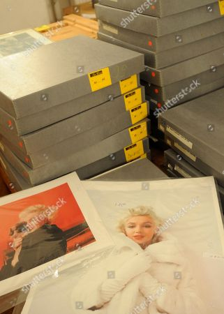 Two photos of Marylin Monroe by the late celebrity photographer Milton H. Greene are pictured among boxes containing more pictures, in Warsaw, Poland. Some 238 pictures by the late photographer Milton H. Greene including portraits of Monroe, along with Cary Grant, Frank Sinatra, Audrey Hepburn, Liza Minnelli, Marlene Dietrich, Paul Newman, Alfred Hitchcock and Marlon Brando, are to be auctioned off in Warsaw on . Proceeds from the auction will go to the Polish state which owns a collection of around 4,000 pictures by Greene
