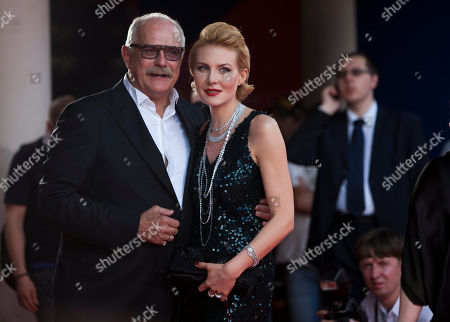 Renata Litvinova, Nikita Mikhalkov Russian filmmaker, actor, and head of the Russian Cinematographers' Union Nikita Mikhalkov, left, and Russian actress, director, and screenwriter Renata Litvinova, pose on the red carpet at the opening ceremony of the 34th Moscow international film festival in Moscow, Russia