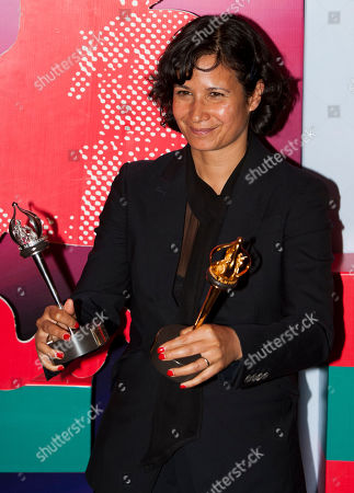 """Tinge Krishnan British film director Tinge Krishnan poses with her trophy on the red carpet at the closing ceremony of the 34th Moscow international film festival in Moscow, Russia, . Krishnan won the Main Prize """"Golden George"""" for the best film"""