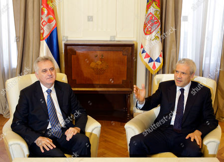 Tomislav Nikolic, Boris Tadic Former Serbian president Boris Tadic, right, speaks and gestures during meeting with newly elected President Tomislav Nikolic, in the Serbian presidency building, in Belgrade, Serbia, . Pro-EU Tadic, who is poised to become the new prime minister after losing the presidential vote, is launching coalition talks for the formation of the next government