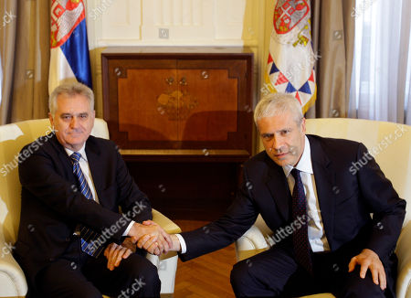 Tomislav Nikolic, Boris Tadic Newly elected Serbian President Tomislav Nikolic, left, shakes hands with former president Boris Tadic during meeting in the Serbian presidency building, in Belgrade, Serbia, . Pro-EU Tadic, who is poised to become the new prime minister after losing the presidential vote, is launching coalition talks for the formation of the next government
