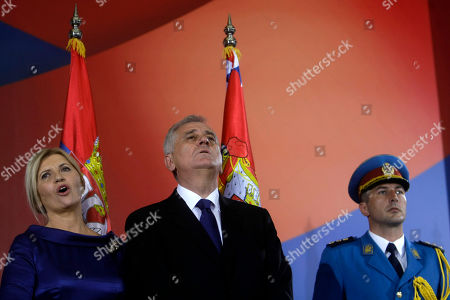 Tomislav Nikolic, Dragica Nikolic Serbian president, Tomislav Nikolic, center, and his wife Dragica, left, sing the national anthem during Nikolic's ceremonial inauguration in Belgrade, Serbia, . Serbia's Balkan neighbors boycotted Nikolic's inauguration on Monday, claiming statements by the new Serbian nationalist leader reignite wartime tensions and cast doubt over his proclaimed pro-European Union goals