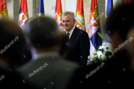 Tomislav Nikolic, Dragica Nikolic Serbian president, Tomislav Nikolic, center, greets guests of honor during his ceremonial inauguration in Belgrade, Serbia, . Serbia's Balkan neighbors boycotted Nikolic's inauguration on Monday, claiming statements by the new Serbian nationalist leader reignite wartime tensions and cast doubt over his proclaimed pro-European Union goals