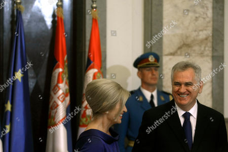 Tomislav Nikolic, Dragica Nikolic Serbian president, Tomislav Nikolic, right, and his wife Dragica, center, share a laugh during Nikolic's ceremonial inauguration in Belgrade, Serbia, . Serbia's Balkan neighbors boycotted Nikolic's inauguration on Monday, claiming statements by the new Serbian nationalist leader reignite wartime tensions and cast doubt over his proclaimed pro-European Union goals