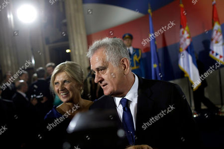 Tomislav Nikolic, Dragica Nikolic Serbian president, Tomislav Nikolic, center, and his wife Dragica, left, speak to guests of honor during Nikolic's ceremonial inauguration in Belgrade, Serbia, . Serbia's Balkan neighbors boycotted Nikolic's inauguration on Monday, claiming statements by the new Serbian nationalist leader reignite wartime tensions and cast doubt over his proclaimed pro-European Union goals