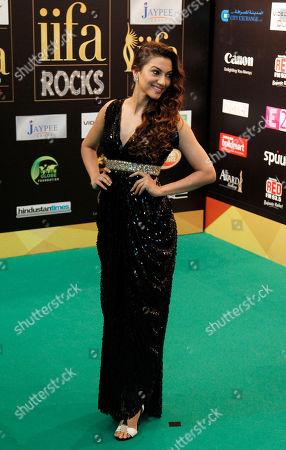 "Gauhar Khan Bollywood actress Gauhar Khan arrives on the ""green carpet"" for the IIFA Rocks! concert as part of a three-day long International Indian Film Academy (IIFA) awards in Singapore"