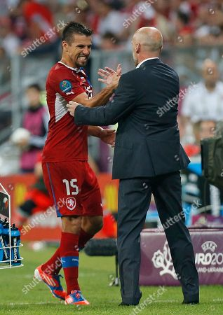 Czech Republic's Milan Baros shakes hands with head coach Michal Bilek during the Euro 2012 soccer championship Group A match between Czech Republic and Poland in Wroclaw, Poland