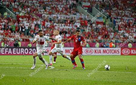 Poland's Marcin Wasilewski, left, Rafal Murawski, center, and Czech Republic's Milan Baros look at the ball during the Euro 2012 soccer championship Group A match between Czech Republic and Poland in Wroclaw, Poland