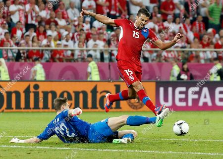 Czech Republic's Milan Baros in action by Poland goalkeeper Przemyslaw Tyton during the Euro 2012 soccer championship Group A match between Czech Republic and Poland in Wroclaw, Poland