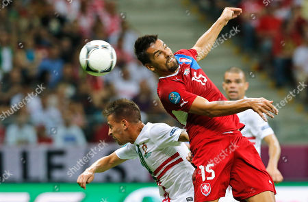 Czech Republic's Milan Baros, right, and Portugal's Joao Pereira go for a header during the Euro 2012 soccer championship quarterfinal match between Czech Republic and Portugal in Warsaw, Poland