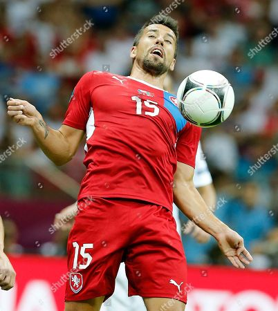 Czech Republic's Milan Baros controls the ball during the Euro 2012 soccer championship quarterfinal match between Czech Republic and Portugal in Warsaw, Poland