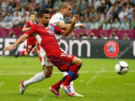 Czech Republic's Milan Baros, left, and and Portugal's Pepe, right, go for the ball during the Euro 2012 soccer championship quarterfinal match between Czech Republic and Portugal in Warsaw, Poland