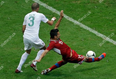 Czech Republic's Milan Baros tries to score past Portugal's Pepe during the Euro 2012 soccer championship quarterfinal match between Czech Republic and Portugal in Warsaw, Poland