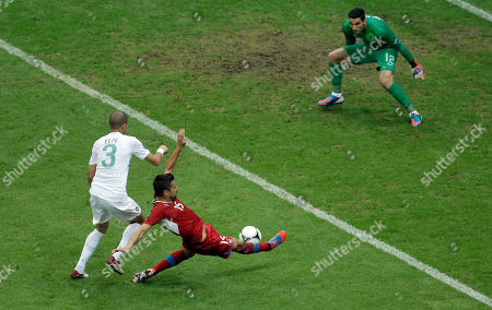 Czech Republic's Milan Baros, center, tries to score against Portugal goalkeeper Rui Patricio, right, and Portugal's Pepe, left, during the Euro 2012 soccer championship quarterfinal match between Czech Republic and Portugal in Warsaw, Poland