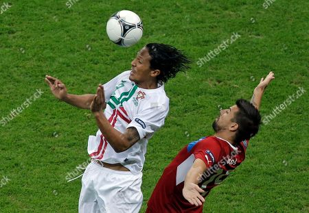 Portugal's Bruno Alves, left, and Czech Republic's Milan Baros go for a header during the Euro 2012 soccer championship quarterfinal match between Czech Republic and Portugal in Warsaw, Poland