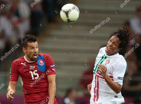 Portugal's Bruno Alves, right, and Czech Republic's Milan Baros vie for the ball during the Euro 2012 soccer championship quarterfinal match between Czech Republic and Portugal in Warsaw, Poland