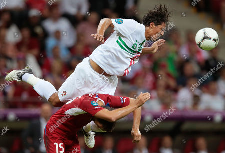 Stock Photo of Portugal's Bruno Alves outleaps Czech Republic's Milan Baros during the Euro 2012 soccer championship quarterfinal match between Czech Republic and Portugal in Warsaw, Poland