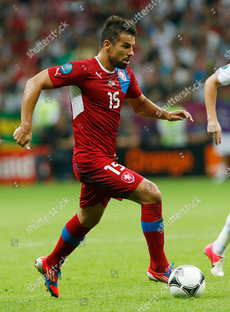 Stock Picture of Milan Baros Czech Republic's Milan Baros controls a ball during the Euro 2012 soccer championship quarterfinal match between Czech Republic and Portugal in Warsaw, Poland