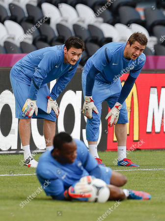 Hugo Lloris, Cedric Carrasso, Steve Mandanda France's goalkeepers Hugo Lloris, background left, and teammate Cedric Carrasso watch Steve Mandanda during the official training in the eve of the Euro 2012 soccer championship Group D match between France and England in Donetsk, Ukraine