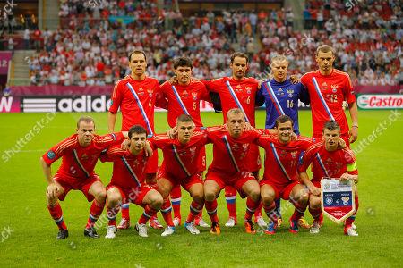 Russian team players from left top: Russia's Sergei Ignashevich. Russia's Yuri Zhirkov, Russia's Roman Shirokov, Russia goalkeeper Vyacheslav Malafeev, Russia's Alexei Berezutski, bottom: Russia's Alexander Anyukov, Russia's Alan Dzagoyev, Russia's Igor Denisov, Russia's Denis Glushakov, Russia's Alexander Kerzhakov, Russia's Andrei Arshavin pose for a photo prior to the Euro 2012 soccer championship Group A match between Greece and Russia in Warsaw, Poland
