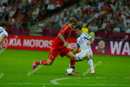 Stock Picture of Russia's Roman Pavlyuchenko fight for the ball with Greece's Giorgos Karagounis during the Euro 2012 soccer championship Group A match between Greece and Russia in Warsaw, Poland