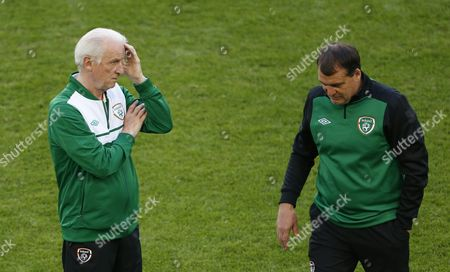 Ireland coach Giovanni Trapattoni, left, and his assistant Marco Tardelli attend a training on the eve of their group C match with Italy at the Euro 2012 soccer tournament in Poznan, Poland